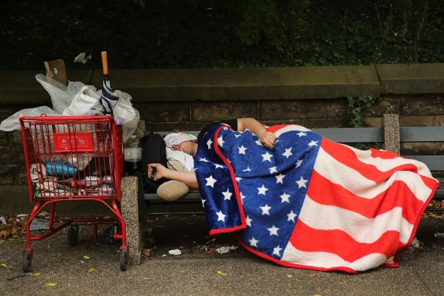 180216257-homeless-man-sleeps-under-an-american-flag-blanket-on-a.jpg.CROP.cq5dam_web_1280_1280_jpeg.jpg